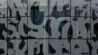 Medienzentrum der BTU Cottbus-Senftenberg: Die Fassade zieren symbolisierte Buchstaben aus allen Weltsprachen.